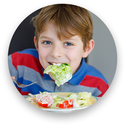 kid eating big boy side salad
